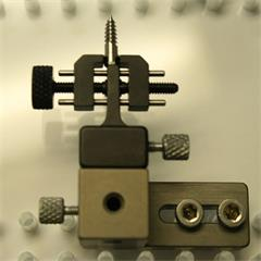 Metal part held using Micro vise clamp with base and Tower block