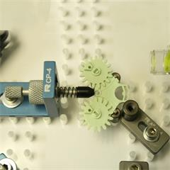 Plastic part held with Pusher clamp, Adjustable slide and Pin standoffs